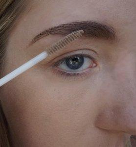 applying clear eyebrow gel
