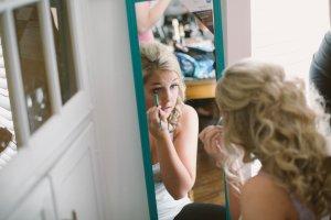 wedding makeup in mirror