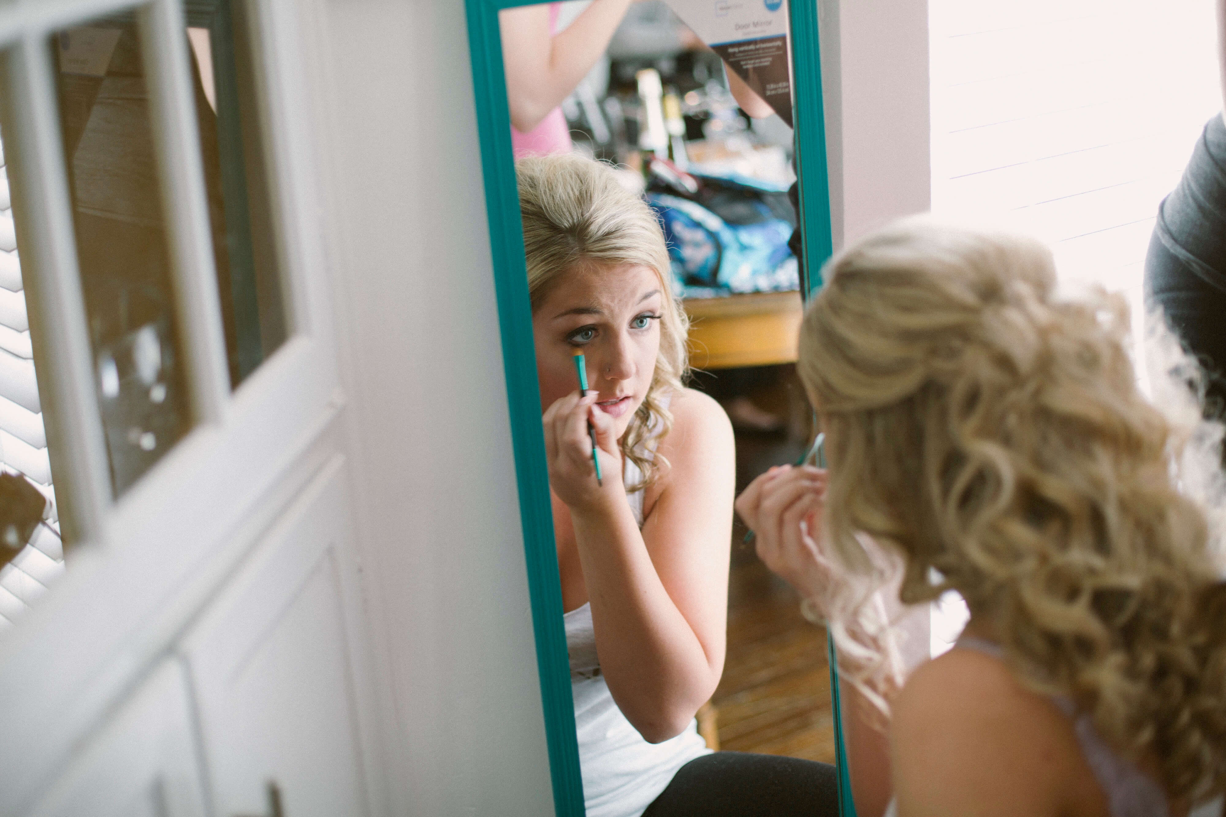 wedding makeup in mirror