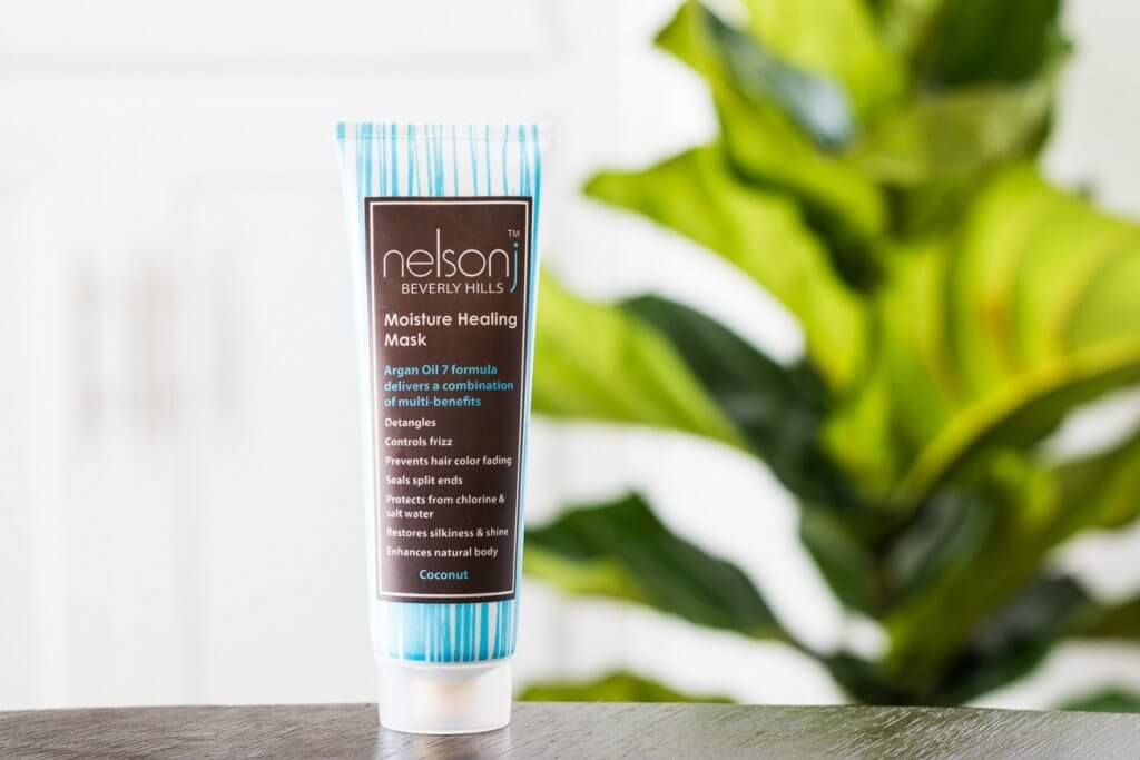 nelson j moisture healing mask in front of green plant